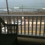 Comfy wicker couch and view of the beach from the veranda