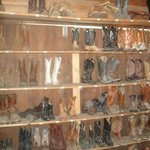 A full wall of boots to choose from if you do not own your own.