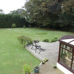 View of rear garden from Room 5 showing corner of conservatory