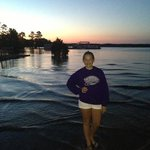 Our daughter enjoying a gorgeous Lake Ouachita sunset at Mountain Harbor Marina.