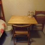 Fold down table and 2 fold down chairs in single room