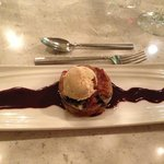 Bread pudding with walnut ice cream over chocolate hazelnut sauce.