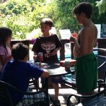 Card games on Grandpa's deck with pool in background