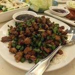 Peking duck meat stir fried with long beans