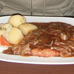 Schnitzel with onions and sauce