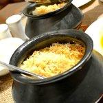 steaming briyanis in pots