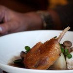 Confit duck with smoked potato, duck consommé & wild mushroom.