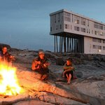 Bonfire gathering by the shore, outside Fogo Island Inn