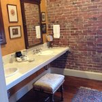 Bathroom with exposed brick walls~beautiful