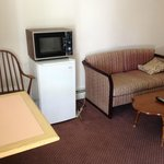 Refrigerator, microwave (from last century) and seating area