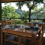 Lovely open air dining with 360 degree views of mountains and ocean