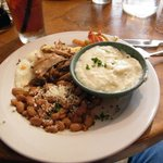 Haitian Breakfast, pork over soft cooked egg, pintos, poblano grits