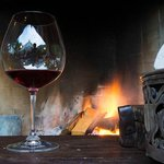 Enjoying wine by the fire