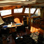A view of the salon and galley from the aft deck companion way