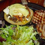 Baked local acorn squash with pork chop and salad