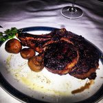 24oz rib steak bone in, cooked Pittsburgh rare.
