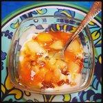 Greek yogurt, peaches, and homemade granola.