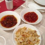 Nice chilli paste and appetizer: almond flakes with pine nuts and anchovies
