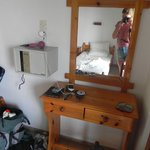 Spacious room with safe, hair dryer, dressing table with light