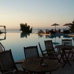 The hotel's beautiful infinity pool at sunset