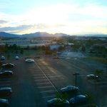 View out of Room #303 window of Flat Iron mountains and other mountains.  Overlooking parking lo