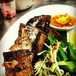 Grilled coconut-braised beef ribs w aromatic salad & nahm pla prik
