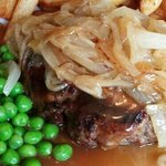 Homemade beefburger, chips, peas & onions.