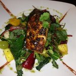 pan seared Cajun salmon over baby greens with fresh fruit salad ..