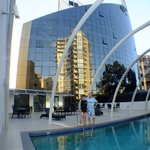 Heated outdoor pool, hotel in background