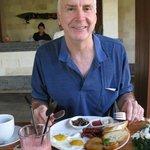 Geoff having breakfast in pavilion near the pool