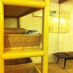 Changing room for hot springs - shelf with baskets for personal belongings