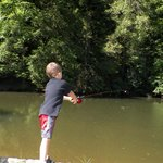 Fishing at the children spot where the stream was dammed up by the state