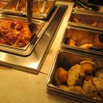 Some buffet food, including muffins and chicken