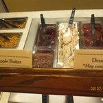 Some food on the salad bar, including dessert