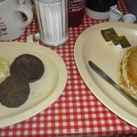 Heavy pancakes and eggs with tough sausage