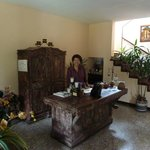 Doña Carmen at reception desk