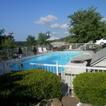 outdoor pool with lots of lounges and chairs and a BBQ !