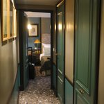 """""""foyer"""" leading up to the room.. the green doors are wardrobe and toilet doors.."""