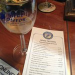 The menu and a glass at the Blue Heron
