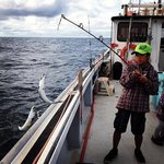my 12 yr old catching 2 mackeral at once!