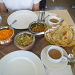 Lunch as served (chicken, fish, Naan, rice)