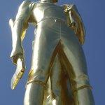 Golden Man atop tower