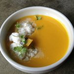 Yellow tomato and peach soup with Thai basil