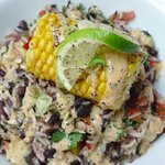 Black bean, rice  and sweetcorn salad with griddled corn on the cob and cajun dressing