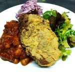 Polenta fried seitan with boston baked beans and coleslaw