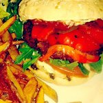 Seitan burger with roasted red peppers,tabasco mayo,jalapenos and spicy chips