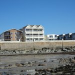View from beach at low tide of suites.