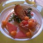 Starter with melone and cured ham
