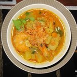 "Delicious seafood-curry, served with rice. If you are brave, order it ""balinese"" style = spicy.."