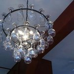 lovely atmosphere and neat decor ideas, such as this wine glass chandelier